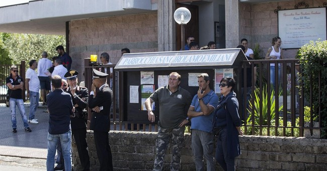 Italy police keep peace at memorial for gangster clan head