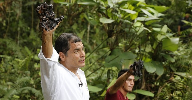 Ecuador's president says country now producing oil at a loss