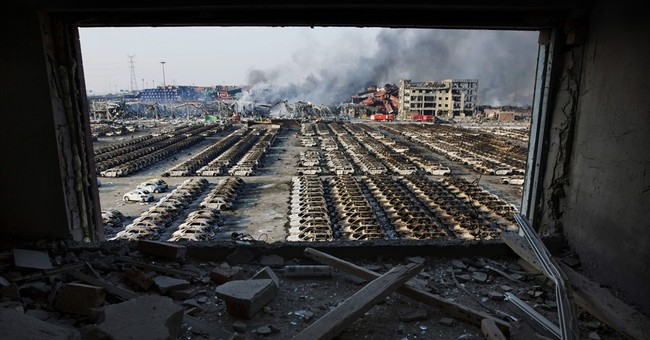 China detains 11 over deadly warehouse explosion