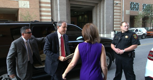 Texas attorney general pleads not guilty to securities fraud