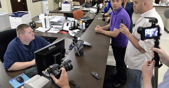 Standoff over gay marriage licenses wears on, despite ruling