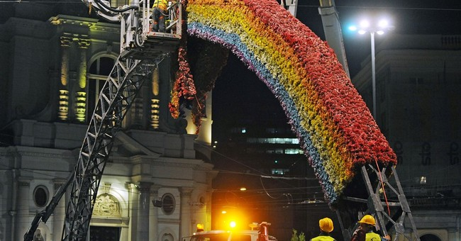 Warsaw's iconic, controversial rainbow taken down at night