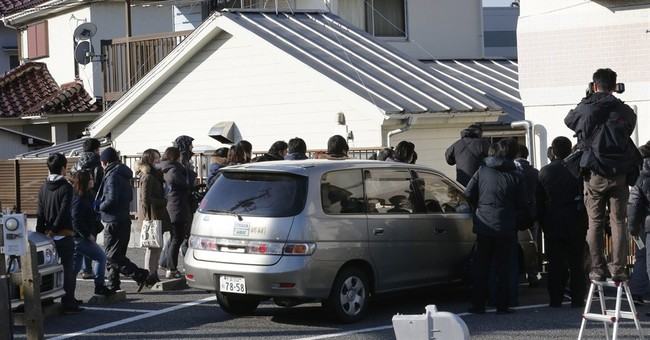 Father of Japanese hostage reported killed still hopeful