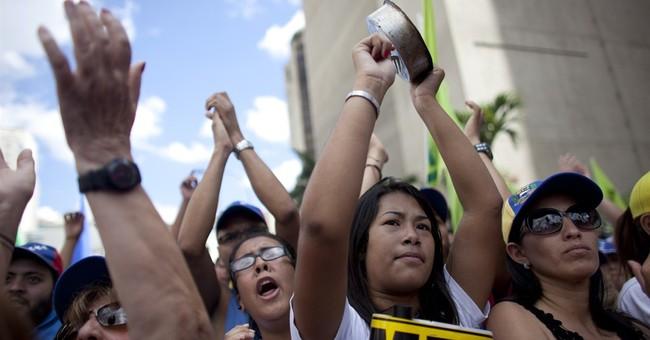 Thousands march against socialist president in Venezuela