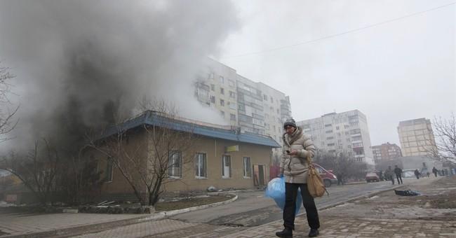 Rockets kill 30 in Ukrainian city as rebels launch offensive
