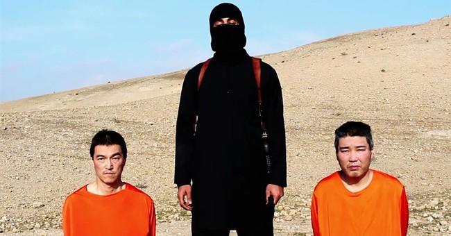 Obama offers condolence to Abe over slain hostage