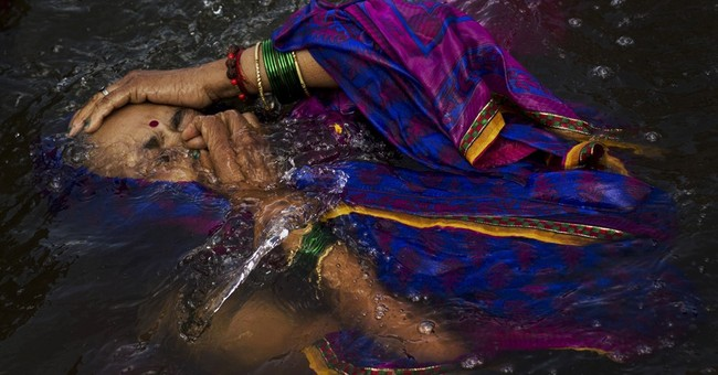 India's river waters cleanse spirits at Hindu festival