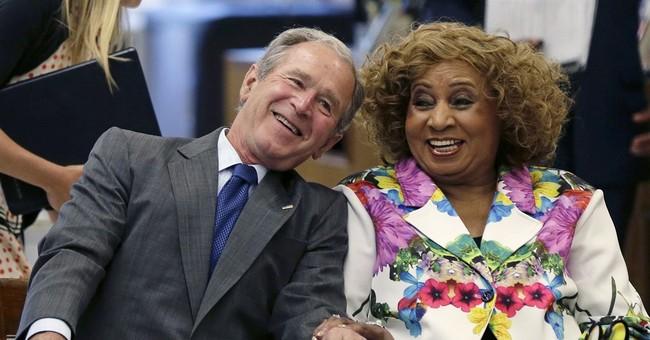 The Latest: Former President Bush arrives in Mississippi