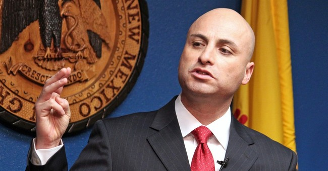 New Mexico secretary of state charged with theft