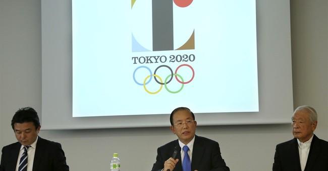 Japan organizers defend designer over logo, deny it's copied