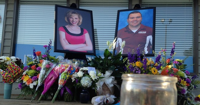 The Latest: Police had contact with killer after firing