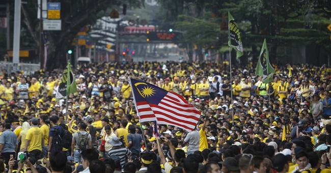 Najib vows not to quit as Malaysia marks National Day