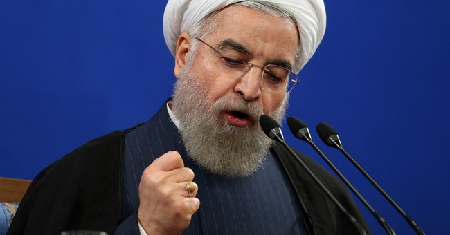 Iran president opposes parliament vote on nuclear deal