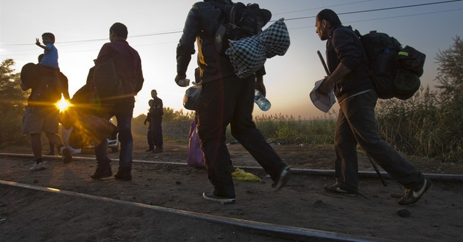 Hungary court orders arrest of 4 men in migrant truck deaths