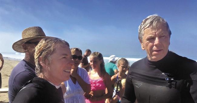 Surfer uninjured after shark bites her board off California
