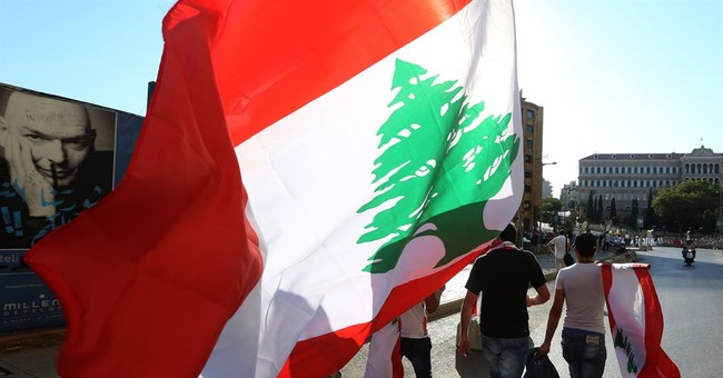 The Latest: Lebanese group threaten to escalate protests