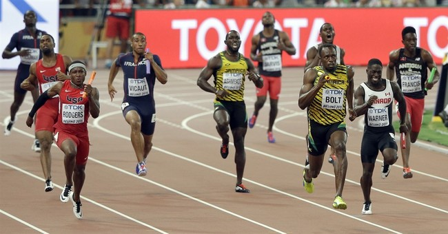 The Latest: US disqualified from men's 4x100 relay at worlds