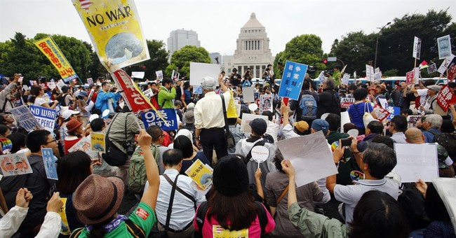 Mothers, students join Japan's protests over security bills