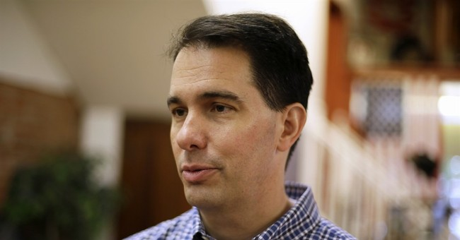 Walker says wall along Canadian border worth reviewing