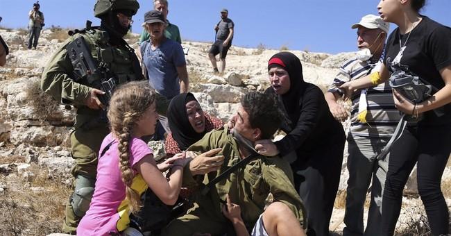 Video shows Palestinian women, Israeli soldier scuffling