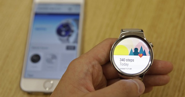 Google tries to woo iPhone owners with Android watch app