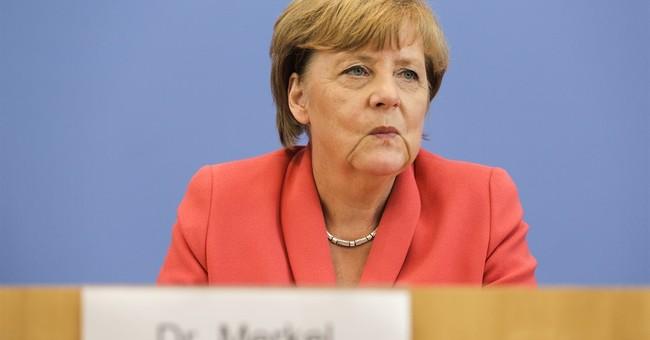 German leader presses for EU to share migrant burden