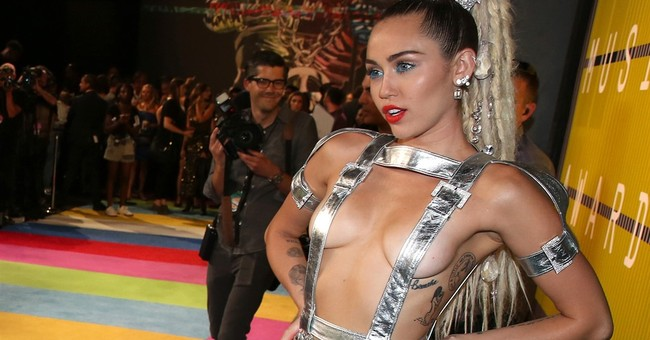 Miley Cyrus' bare-breast flash nothing like Janet Jackson's