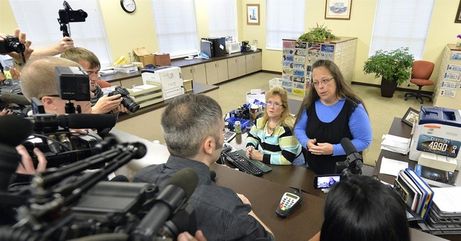 A look at couples suing over marriage licenses in Kentucky