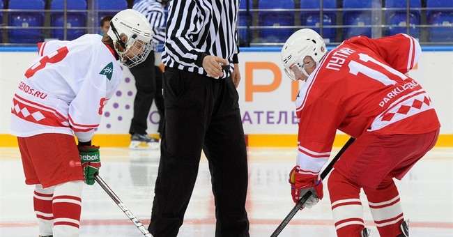 Putin takes part in hockey game against students in Russia