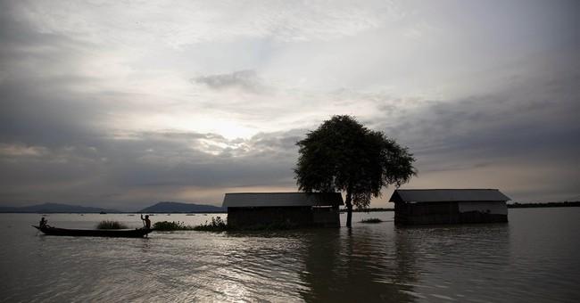 Monsoon floods swamp northeast Indian villages, 21 dead