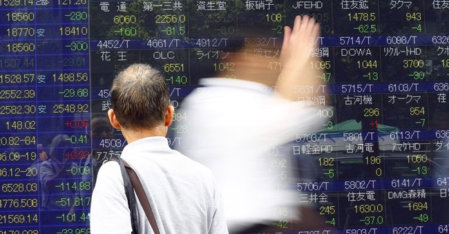 China leads Asian stocks lower on poor factory data