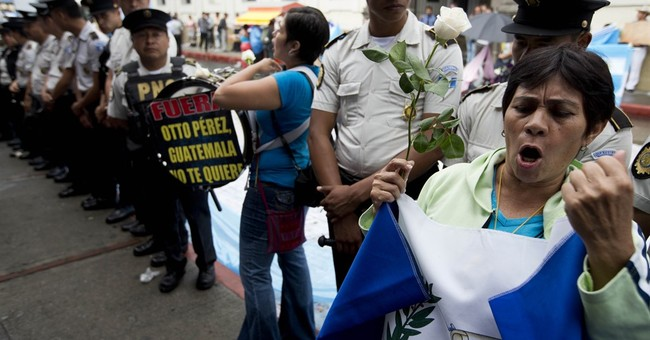 Immunity lifted, prosecutors close in on Guatemala president