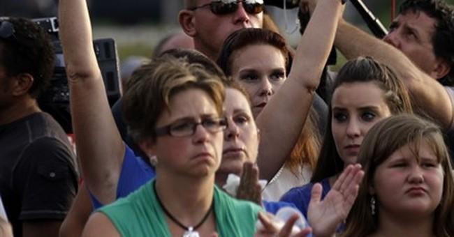 The Latest: Funeral arrangements announced for slain officer