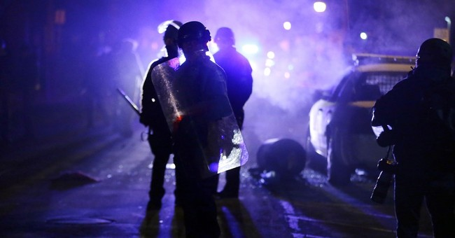 Report on Ferguson unrest offers lessons in what not to do