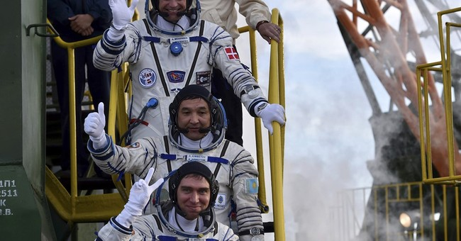 Soyuz with Russian, Dane, Kazakh docks at space station