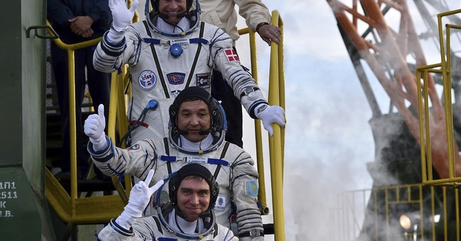 Soyuz carrying 3-man crew blasts off for orbiting station