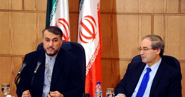 Iran says Assad has 'pivotal' role in any Syria solution