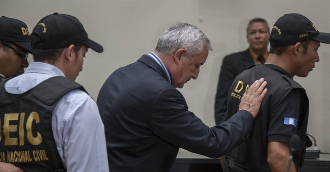 Guatemala ex-president goes to court after night behind bars
