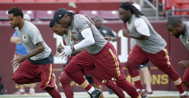 Concussion doctor who handled RG3 case resigns from post