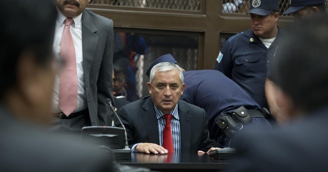 Guatemala swears in new president after Perez Molina resigns