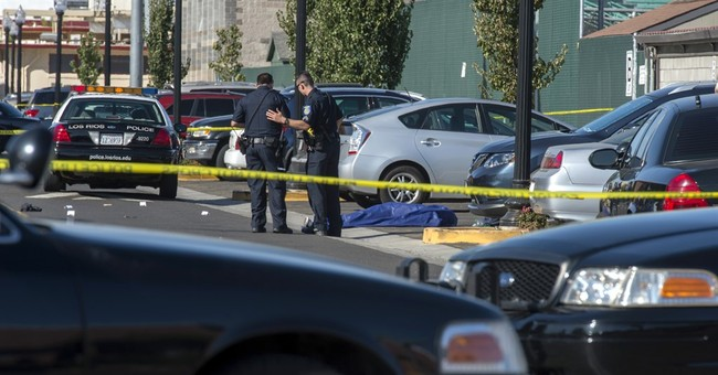 1 jailed, gunman still sought in Sacramento college shooting