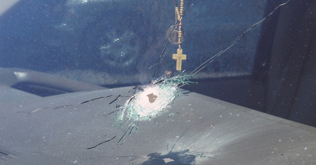 Window shatters on freeway as police investigate shootings