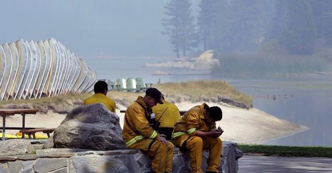 Vast, stubborn California fire to rage through long weekend