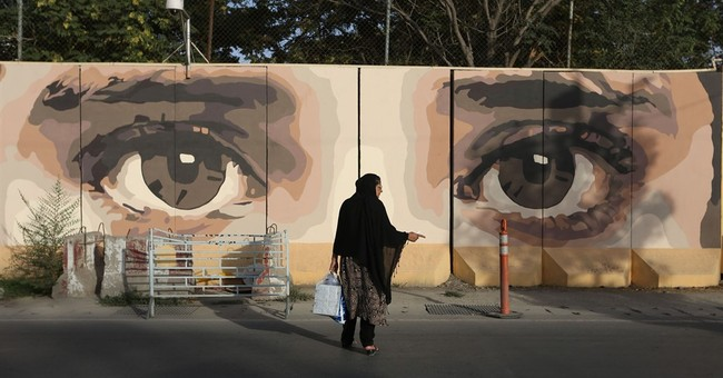 Afghan artist paints Kabul's walls of war to help heal city