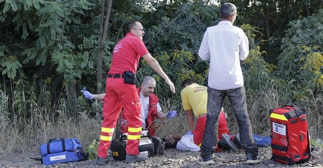 The Latest: Migrants reach Austrian border