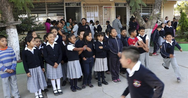 Officials wrench control of schools from Mexico unions