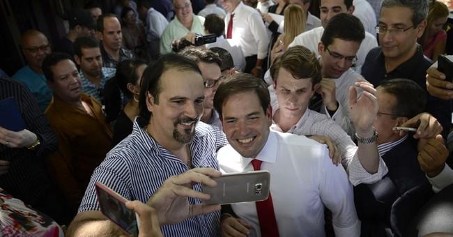 Clinton, Rubio court Puerto Rico voters as crisis looms