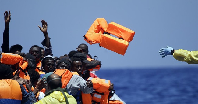 AP PHOTOS: Haunting images of people fleeing their homelands