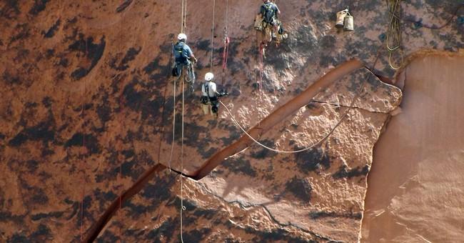 Massive rock threatening to crash into base of Arizona dam