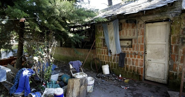 Argentine accused of locking wife, autistic son in cage